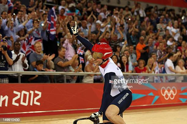 Jason Kenny of Great Britain celebrates winning the Men's Sprint Track Cycling Final and the gold medal on Day 10 of the London 2012 Olympic Games at...