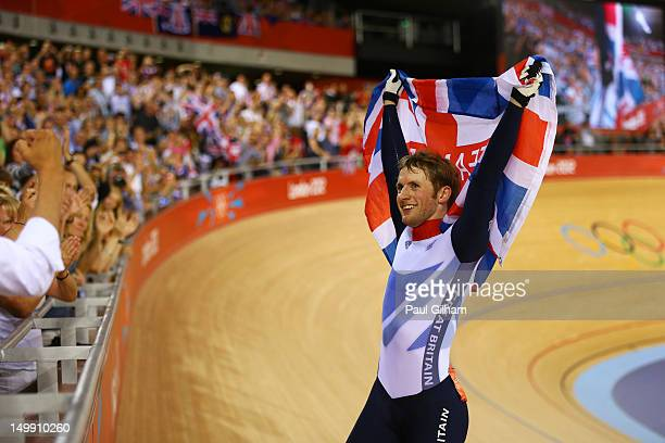 Jason Kenny of Great Britain celebrates winning the second heat against Gregory Bauge of France during the Men's Sprint Track Cycling Final and...
