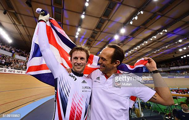 Jason Kenny of Great Britain celebrates with Coach Justin Grace after winning the Men's Sprint Final during Day Four of the UCI Track Cycling World...