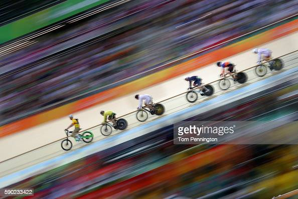 Jason Kenny of Great Britain Matthijs Buchli of the Netherlands Azizulhasni Awang of Malaysia compete during the Men's Keirin Finals race on Day 11...