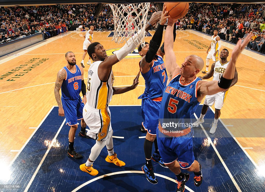Jason Kidd #5 and Carmelo Anthony #7 of the New York Knicks go for a rebound against Roy Hibbert #55 of the Indiana Pacers a during the game between the Indiana Pacers and the New York Knicks on February 20, 2013 at Bankers Life Fieldhouse in Indianapolis, Indiana.