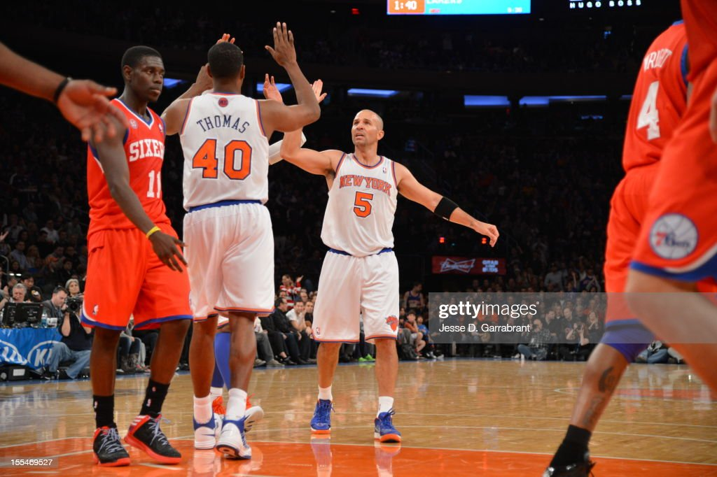 Jason Kidd #5 and Kurt Thomas #40 of the New York Knicks give eachother a high five vs the Philadelphia 76ers on November 4, 2012 at Madison Square Garden in New York City.