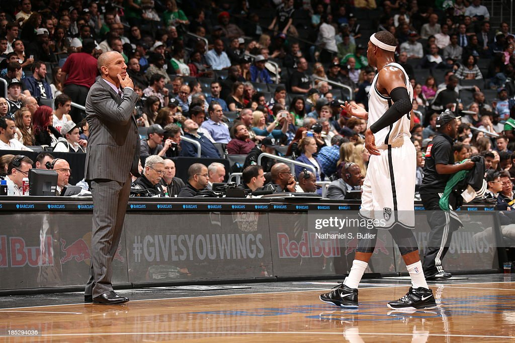 <a gi-track='captionPersonalityLinkClicked' href=/galleries/search?phrase=Jason+Kidd&family=editorial&specificpeople=201560 ng-click='$event.stopPropagation()'>Jason Kidd</a> and <a gi-track='captionPersonalityLinkClicked' href=/galleries/search?phrase=Paul+Pierce&family=editorial&specificpeople=201562 ng-click='$event.stopPropagation()'>Paul Pierce</a> #34 of the Brooklyn Nets talk during the game against the Boston Celtics during a preseason game at the Barclays Center on October 15, 2013 in the Brooklyn borough of New York City.
