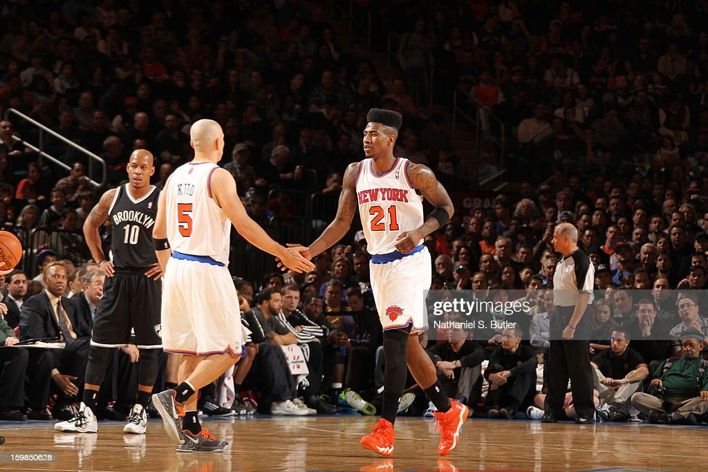 Jason Kidd #5 congratulates teammate Iman Shumpert #21 of the New York Knicks during the game against the Brooklyn Nets on January 21, 2013 at Madison Square Garden in New York City.