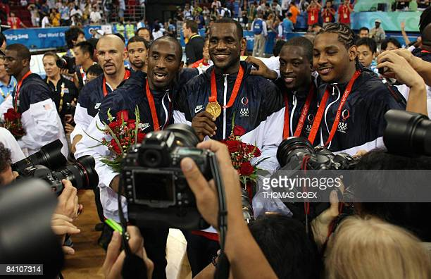 US Jason Kidd Kobe Bryant LeBron James Dwyane Wade and Carmelo Anthony pose with their medals after the men's basketball gold medal match of the...