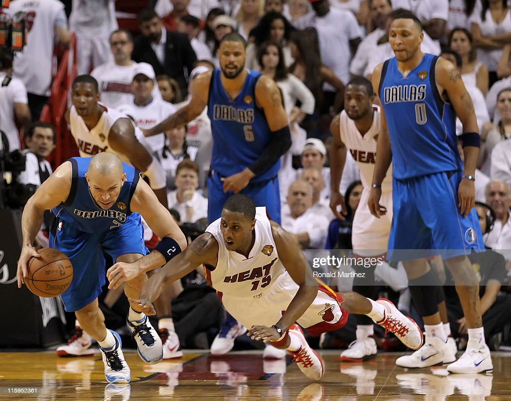Jason Kidd of the Dallas Mavericks controls a loose ball against Mario Chalmers of the Miami Heat in Game Six of the 2011 NBA Finals at American...