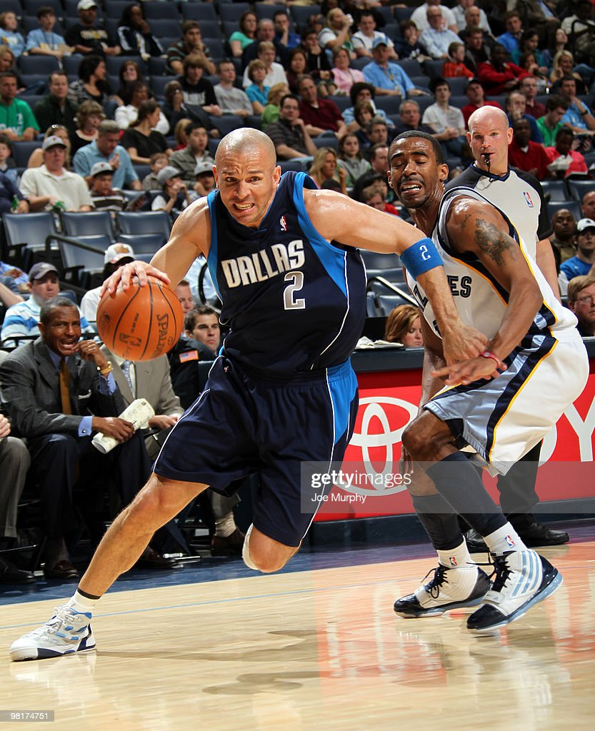 Jason Kidd #2 of the Dallas Mavericks drives around Mike Conley #11 of the Memphis Grizzlies on March 31, 2010 at FedExForum in Memphis, Tennessee.