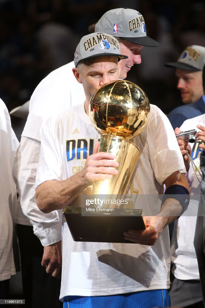 Jason Kidd of the Dallas Mavericks kisses the Larry O'Brien trophy after the Mavericks won 10595 against the Miami Heat in Game Six of the 2011 NBA...