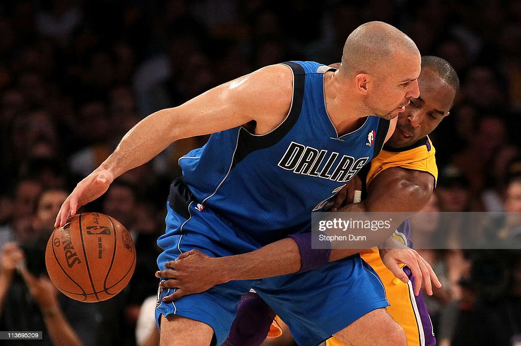 <a gi-track='captionPersonalityLinkClicked' href=/galleries/search?phrase=Jason+Kidd&family=editorial&specificpeople=201560 ng-click='$event.stopPropagation()'>Jason Kidd</a> #2 of the Dallas Mavericks moves the ball as <a gi-track='captionPersonalityLinkClicked' href=/galleries/search?phrase=Kobe+Bryant&family=editorial&specificpeople=201466 ng-click='$event.stopPropagation()'>Kobe Bryant</a> #24 of the Los Angeles Lakers goes for the steal in the first quarter in Game Two of the Western Conference Semifinals in the 2011 NBA Playoffs at Staples Center on May 4, 2011 in Los Angeles, California.
