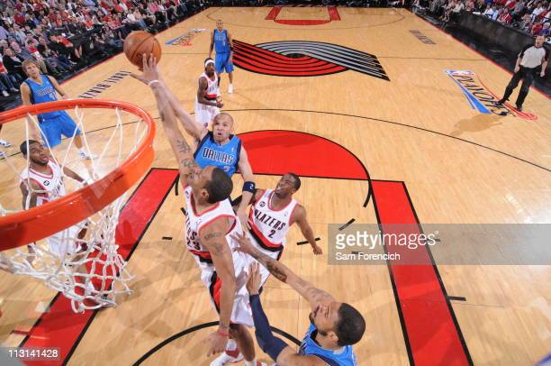 Jason Kidd of the Dallas Mavericks shoots against Marcus Camby of the Portland Trail Blazers in Game Four of the Western Conference Quarterfinals in...