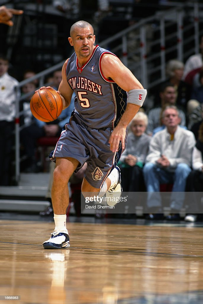 Jason Kidd of the New Jersey Nets dribbles the ball during the game against the Minnesota Timberwolves at Target Center on November 23 2002 in...