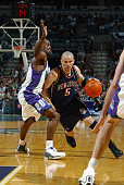 Jason Kidd of the New Jersey Nets drives against Gary Payton of the Milwaukee Bucks in Game six of the Eastern Conference Quarterfinals during the...