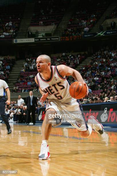 Jason Kidd of the New Jersey Nets drives against the Philadelphia 76ers during the game at Continental Airlines Arena on February 7 2005 in East...