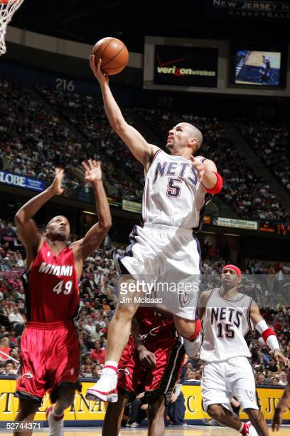 Jason Kidd of the New Jersey Nets drives to the basket past Shandon Anderson of the Miami Heat in Game four of the Eastern Conference Quarterfinals...