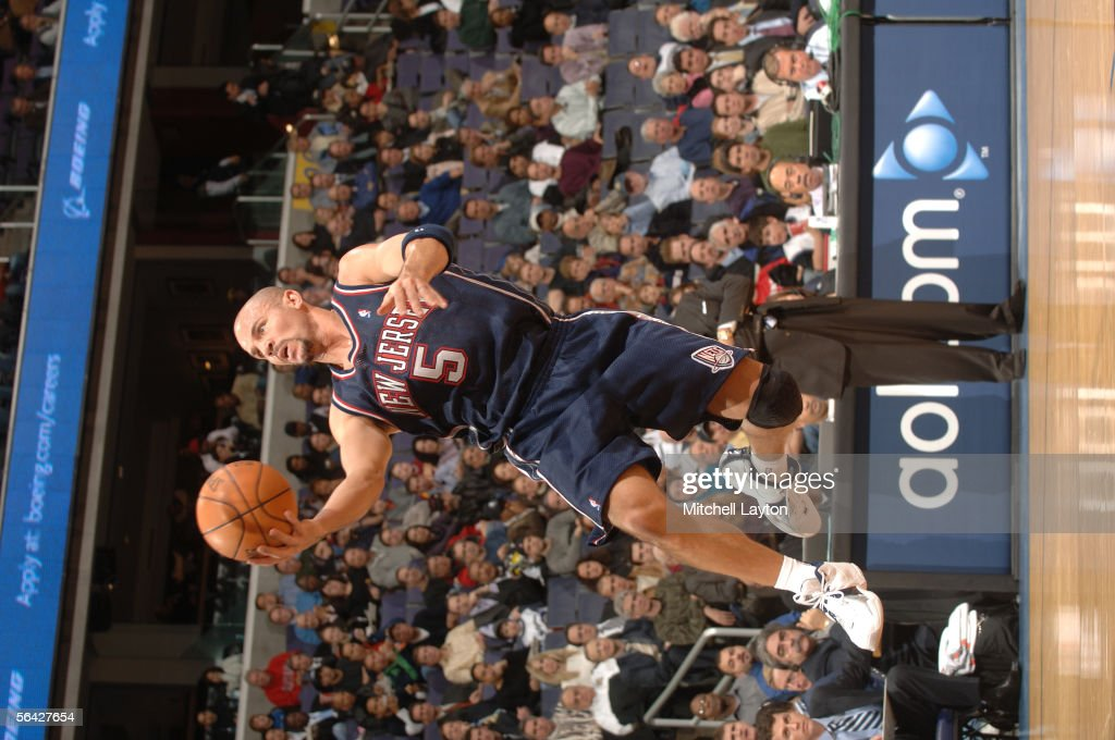 3886908cb016 ... Swingman Jersey Jason Kidd 5 of the New Jersey Nets goes for a layup  against the Washington ...