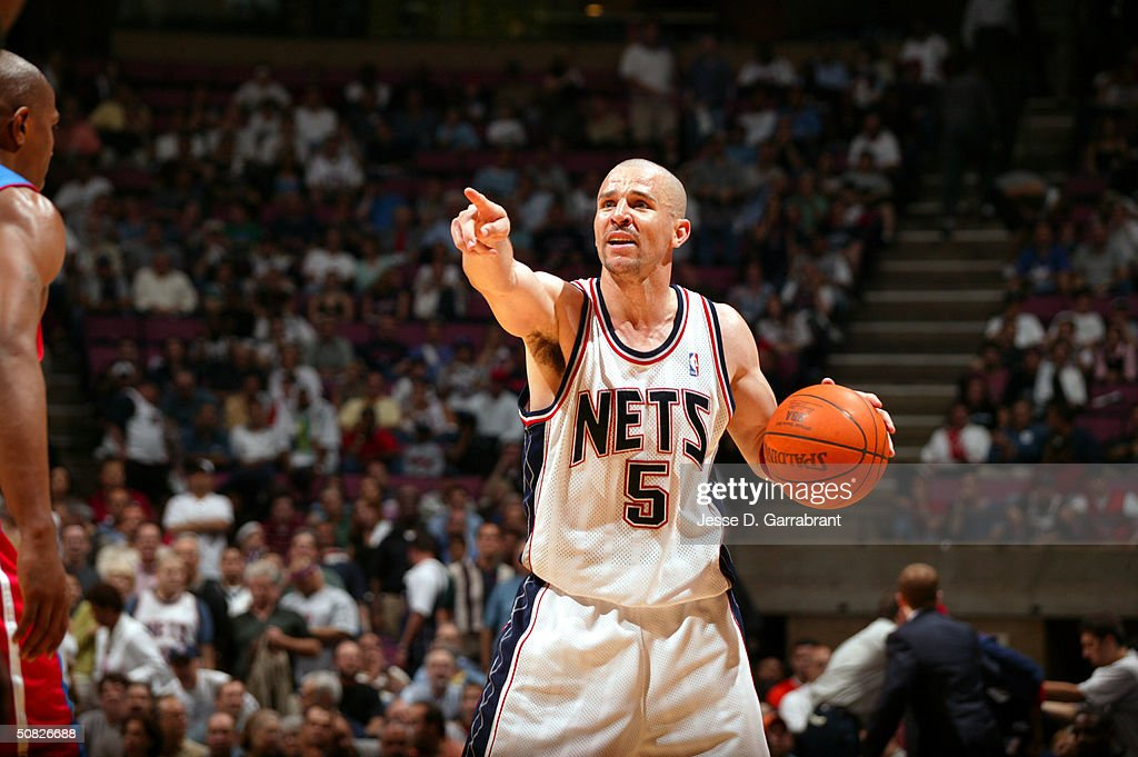 Jason Kidd of the New Jersey Nets ldirects the offense against Chauncey Billups of the Detroit Pistons in Game four of the Eastern Conference...