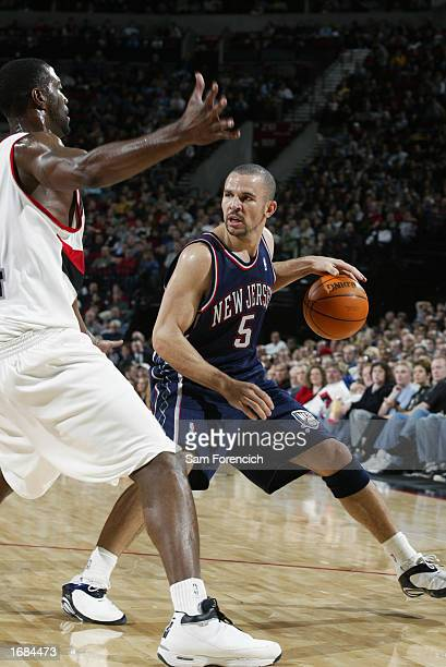 Jason Kidd of the New Jersey Nets looks to pass against the Portland Trail Blazers during the game at the Rose Garden on November 30 2002 in Portland...