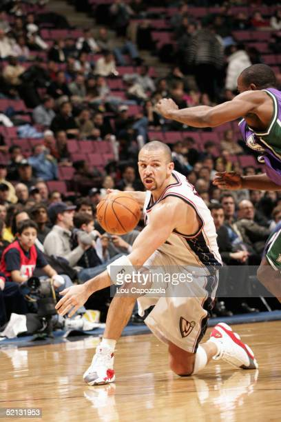 Jason Kidd of the New Jersey Nets moves the ball during the game with the Milwaukee Bucks on January 19 2005 at the Continental Airlines Arena in...