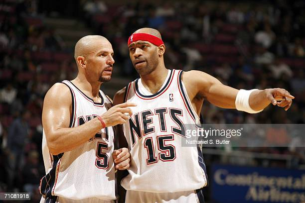 Jason Kidd of the New Jersey Nets talks with his teammate Vince Carter in game four of the Eastern Conference Semifinals against the Miami Heat...