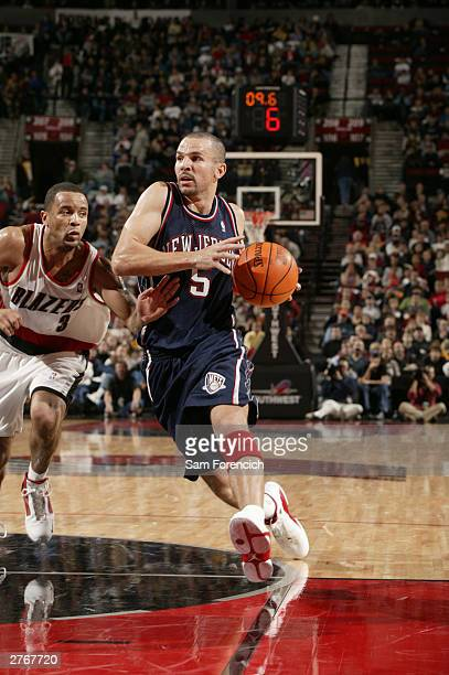 Jason Kidd of the New Jersey Nets tries to get past Damon Stoudamire of the Portland Trail Blazers during a game on November 28 2003 at the Rose...