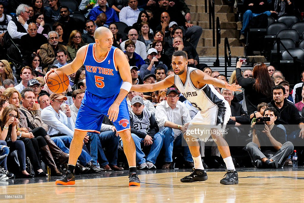 Jason Kidd #5 of the New York Knicks controls the ball against Patrick Mills #8 of the San Antonio Spurs on November 15, 2012 at the AT&T Center in San Antonio, Texas.