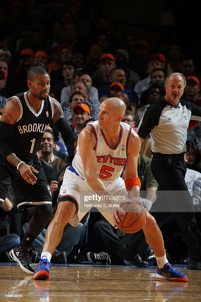 Jason Kidd #5 of the New York Knicks handles the ball against C.J. Watson #1 of the Brooklyn Nets on December 19, 2012 at Madison Square Garden in New York City.