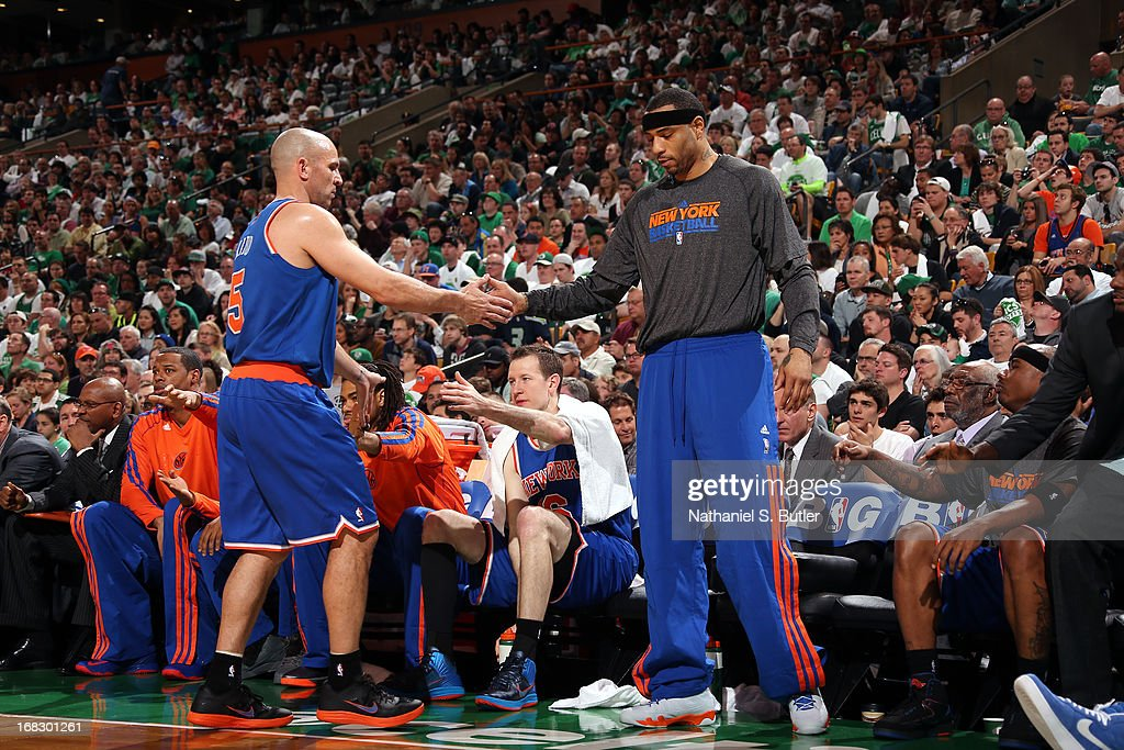 <a gi-track='captionPersonalityLinkClicked' href=/galleries/search?phrase=Jason+Kidd&family=editorial&specificpeople=201560 ng-click='$event.stopPropagation()'>Jason Kidd</a> #5 of the New York Knicks high fives teammate <a gi-track='captionPersonalityLinkClicked' href=/galleries/search?phrase=Kenyon+Martin&family=editorial&specificpeople=201522 ng-click='$event.stopPropagation()'>Kenyon Martin</a> #3 of the New York Knicks in Game Four of the Eastern Conference Quarterfinals during the 2013 NBA Playoffs on April 28, 2013 at the TD Garden in Boston.