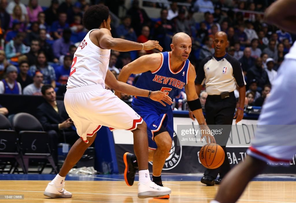 Jason Kidd #5 of the New York Knicks in action against Josh Childress #2 of the Brooklyn Nets during a preseason game at Nassau Coliseum on October 24 2012 in Uniondale, New York The Knicks defeated the Nets 97-95.
