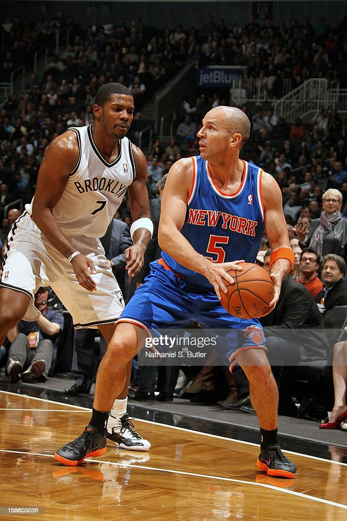 Jason Kidd #5 of the New York Knicks looks to pass the ball around Joe Johnson #7 of the Brooklyn Nets on December 11, 2012 at the Barclays Center in the Brooklyn borough of New York City.