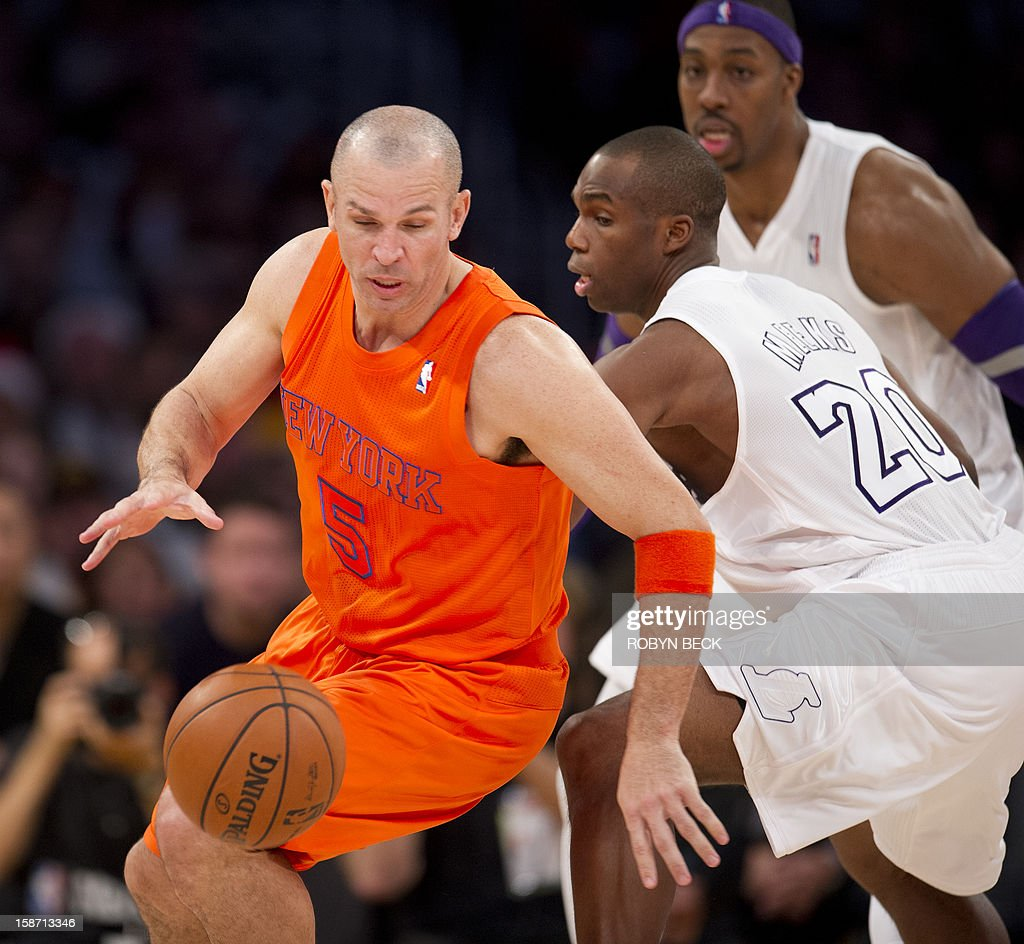 Jason Kidd of the New York Knicks powers around Los Angeles Lakers Jodie Meeks at Staples Center in Los Angeles, California, on Christmas Day, December 25, 2012. The Lakers defeated the Knicks 100-94. AFP PHOTO / Robyn Beck
