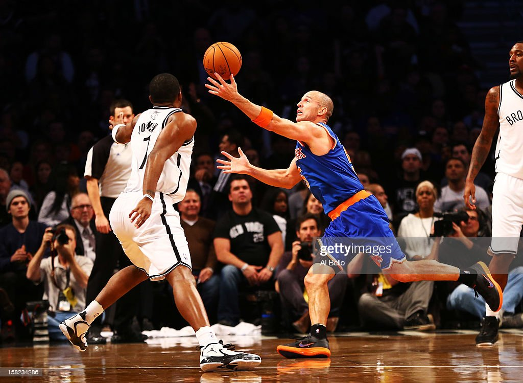Jason Kidd #5 of the New York Knicks reaches for the ball past Joe Johnson #7 of the Brooklyn Nets during their game at the Barclays Center on December 11, 2012 in the Brooklyn borough of New York City.