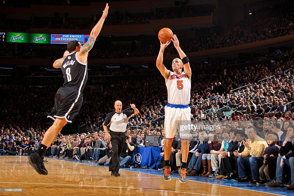 Jason Kidd #5 of the New York Knicks shoots a three-pointer against Deron Williams #8 of the Brooklyn Nets on January 21, 2013 at Madison Square Garden in New York City.