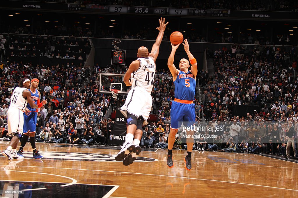 Jason Kidd #5 of the New York Knicks shoots the wining three point shot against Jerry Stackhouse #42 of the Brooklyn Nets December 11, 2012 at the Barclays Center in the Brooklyn borough of New York City.