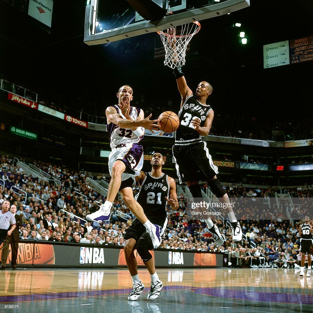 Jason Kidd of the Phoenix Suns makes a pass against the San Antonio Spurs during an NBA game circa 2000 in Phoenix Arizona NOTE TO USER User...