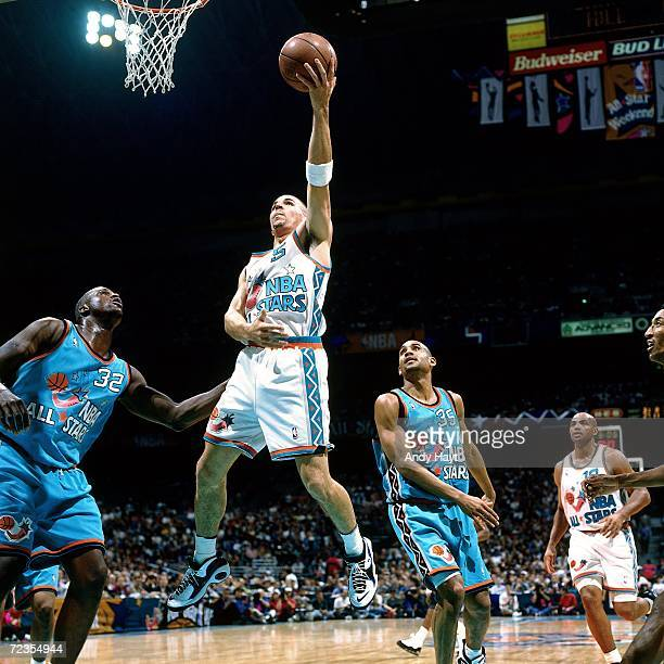 Jason Kidd of the Western Conference All Stars attempts a layup against Shaquille O'Neal of the Eastern Conference All Stars during the 1996 NBA All...