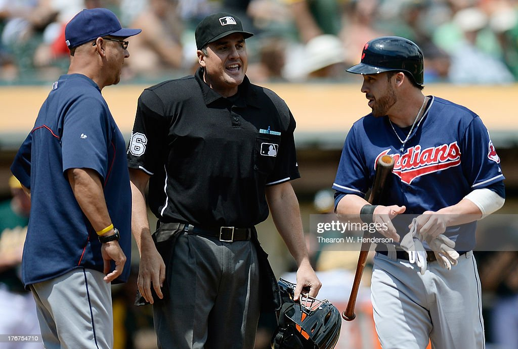 <a gi-track='captionPersonalityLinkClicked' href=/galleries/search?phrase=Jason+Kipnis&family=editorial&specificpeople=5330784 ng-click='$event.stopPropagation()'>Jason Kipnis</a> #22 and manager <a gi-track='captionPersonalityLinkClicked' href=/galleries/search?phrase=Terry+Francona&family=editorial&specificpeople=171936 ng-click='$event.stopPropagation()'>Terry Francona</a> #17 argue a strike three call with home plate umpire Mike DiMuro #16 in the first inning against the Oakland Athletics at O.co Coliseum on August 18, 2013 in Oakland, California.