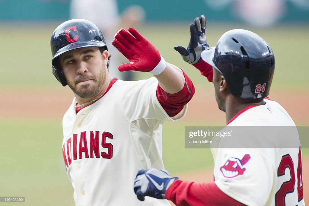 Jason Kipnis #22 and Michael Bourn #24 of the Cleveland Indians celebrate after Bourn scored on a sacrifice fly hit by Kipnis during the first inning against the New York Yankees on opening day at Progressive Field on April 8, 2013 in Cleveland, Ohio.