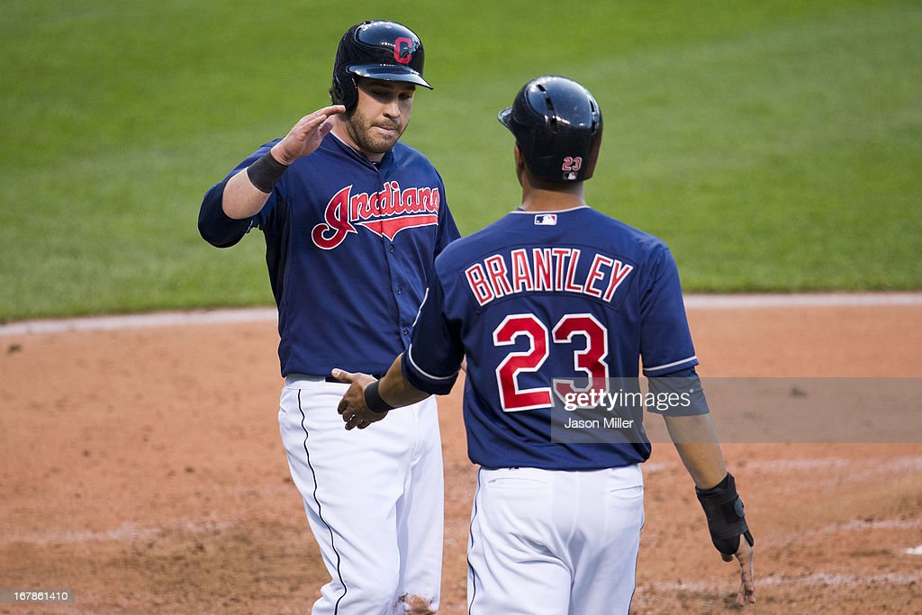 <a gi-track='captionPersonalityLinkClicked' href=/galleries/search?phrase=Jason+Kipnis&family=editorial&specificpeople=5330784 ng-click='$event.stopPropagation()'>Jason Kipnis</a> #22 and Michael Brantley #23 of the Cleveland Indians celebrate after scoring on double by Asdrubal Cabrera #13 during the third inning against the Philadelphia Phillies at Progressive Field on May 1, 2013 in Cleveland, Ohio.