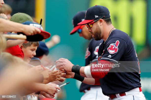 Jason Kipnis and Michael Brantley of the Cleveland Indians sign autographs before the game against the New York Yankees at Progressive Field on...