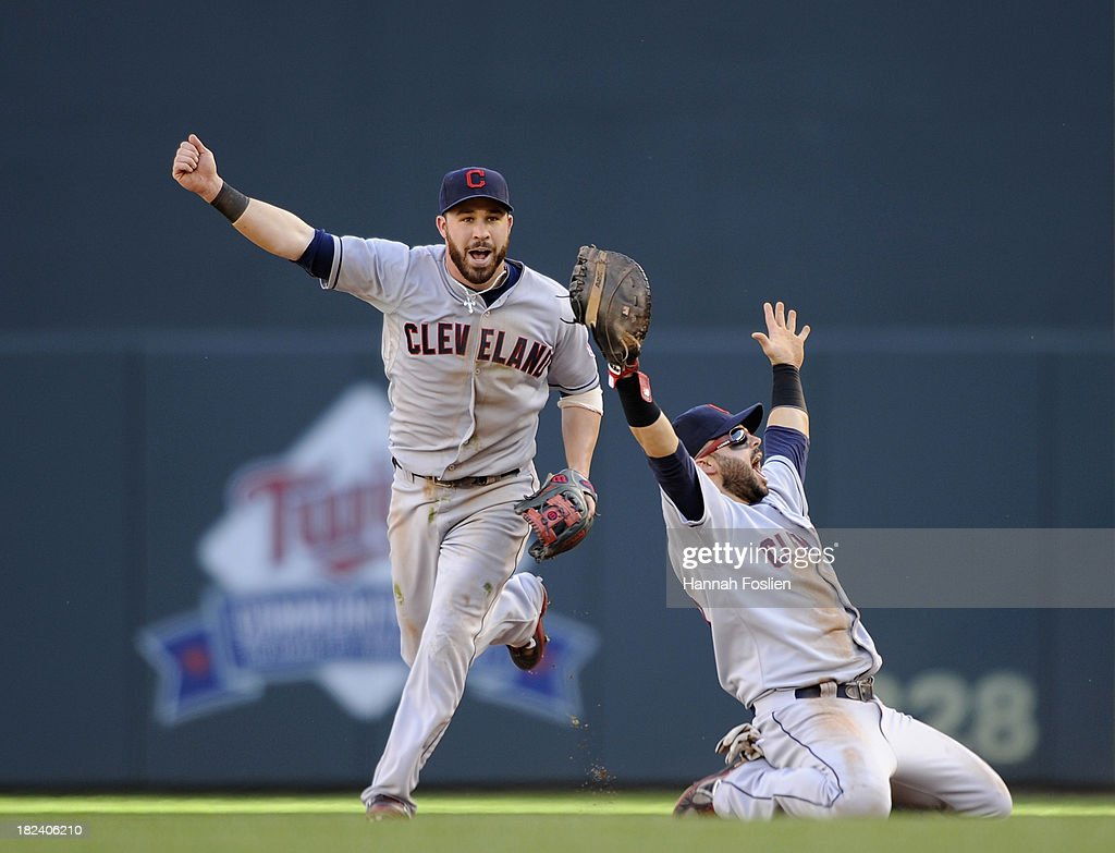 <a gi-track='captionPersonalityLinkClicked' href=/galleries/search?phrase=Jason+Kipnis&family=editorial&specificpeople=5330784 ng-click='$event.stopPropagation()'>Jason Kipnis</a> #22 and <a gi-track='captionPersonalityLinkClicked' href=/galleries/search?phrase=Nick+Swisher&family=editorial&specificpeople=206417 ng-click='$event.stopPropagation()'>Nick Swisher</a> #33 of the Cleveland Indians celebrate a win of the game against the Minnesota Twins on September 29, 2013 at Target Field in Minneapolis, Minnesota. The Indians defeated the Twins 5-1 and clinched a American League Wild Card berth.
