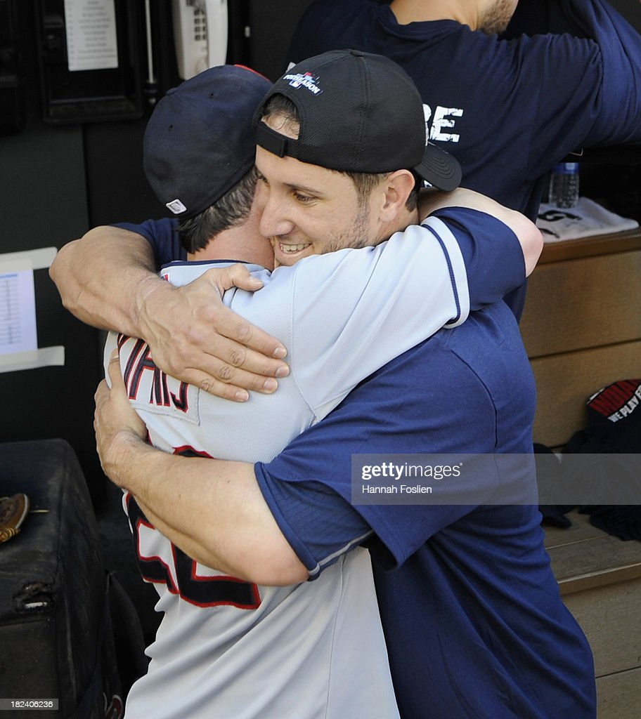 <a gi-track='captionPersonalityLinkClicked' href=/galleries/search?phrase=Jason+Kipnis&family=editorial&specificpeople=5330784 ng-click='$event.stopPropagation()'>Jason Kipnis</a> #22 and <a gi-track='captionPersonalityLinkClicked' href=/galleries/search?phrase=Yan+Gomes&family=editorial&specificpeople=9004037 ng-click='$event.stopPropagation()'>Yan Gomes</a> #10 of the Cleveland Indians celebrate a win of the game against the Minnesota Twins on September 29, 2013 at Target Field in Minneapolis, Minnesota. The Indians defeated the Twins 5-1 and clinched a American League Wild Card berth.