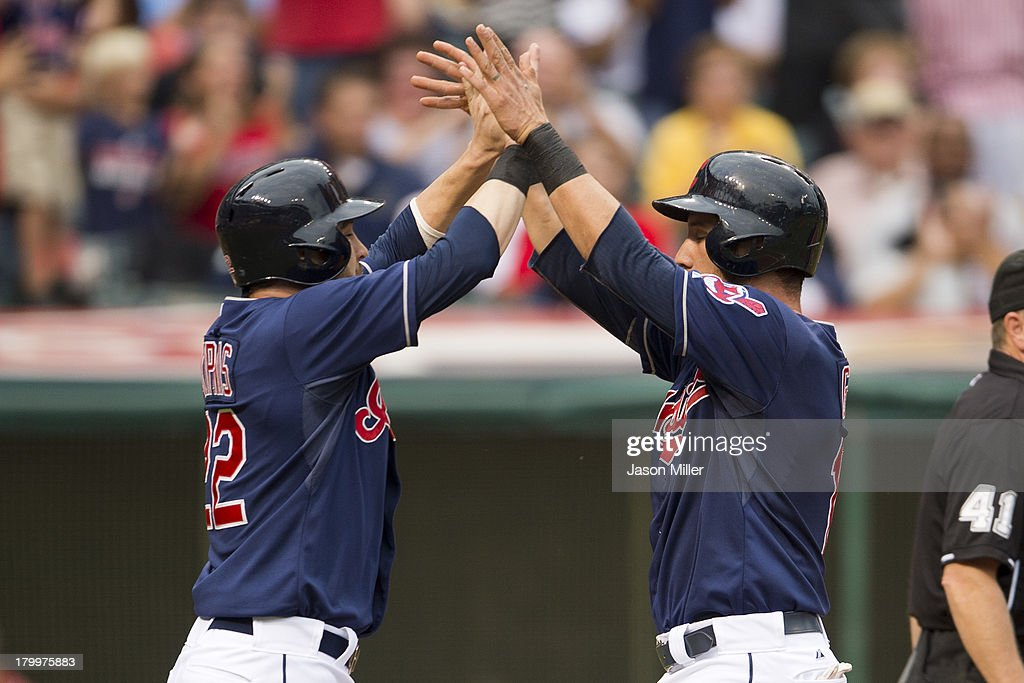 <a gi-track='captionPersonalityLinkClicked' href=/galleries/search?phrase=Jason+Kipnis&family=editorial&specificpeople=5330784 ng-click='$event.stopPropagation()'>Jason Kipnis</a> #22 and <a gi-track='captionPersonalityLinkClicked' href=/galleries/search?phrase=Yan+Gomes&family=editorial&specificpeople=9004037 ng-click='$event.stopPropagation()'>Yan Gomes</a> #10 of the Cleveland Indians celebrate after scoring off a double by Ryan Raburn #9 during the first inning against the New York Mets at Progressive Field on September 7, 2013 in Cleveland, Ohio.