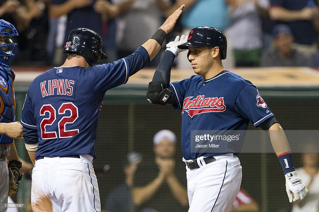 <a gi-track='captionPersonalityLinkClicked' href=/galleries/search?phrase=Jason+Kipnis&family=editorial&specificpeople=5330784 ng-click='$event.stopPropagation()'>Jason Kipnis</a> #22 celebrates with <a gi-track='captionPersonalityLinkClicked' href=/galleries/search?phrase=Asdrubal+Cabrera&family=editorial&specificpeople=834042 ng-click='$event.stopPropagation()'>Asdrubal Cabrera</a> #13 of the Cleveland Indians after Cabrera hit a three run home run during the seventh inning against the New York Mets at Progressive Field on September 7, 2013 in Cleveland, Ohio.