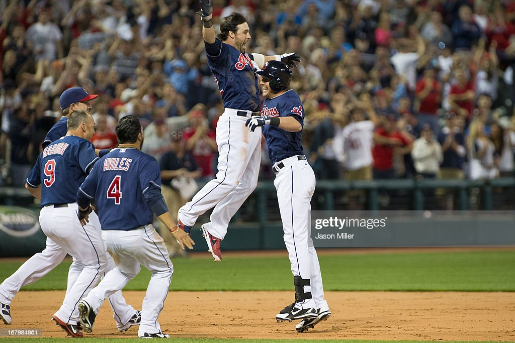 <a gi-track='captionPersonalityLinkClicked' href=/galleries/search?phrase=Jason+Kipnis&family=editorial&specificpeople=5330784 ng-click='$event.stopPropagation()'>Jason Kipnis</a> #22 celebrates with Drew Stubbs #11 of the Cleveland Indians after Stubbs hit a walk-off double during the tenth inning against the Minnesota Twins at Progressive Field on May 3, 2013 in Cleveland, Ohio. The Indians defeated the Twins 7-6.