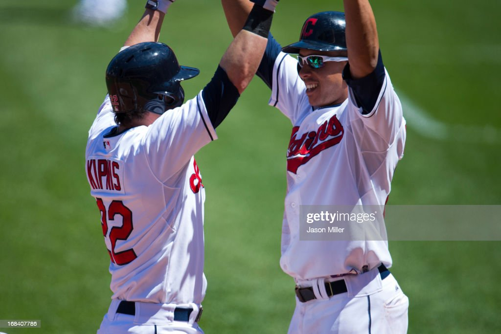 <a gi-track='captionPersonalityLinkClicked' href=/galleries/search?phrase=Jason+Kipnis&family=editorial&specificpeople=5330784 ng-click='$event.stopPropagation()'>Jason Kipnis</a> #22 celebrates with Michael Brantley #23 of the Cleveland Indians after Kipnis hit a two run home run during the second inning against the Oakland Athletics at Progressive Field on May 9, 2013 in Cleveland, Ohio.