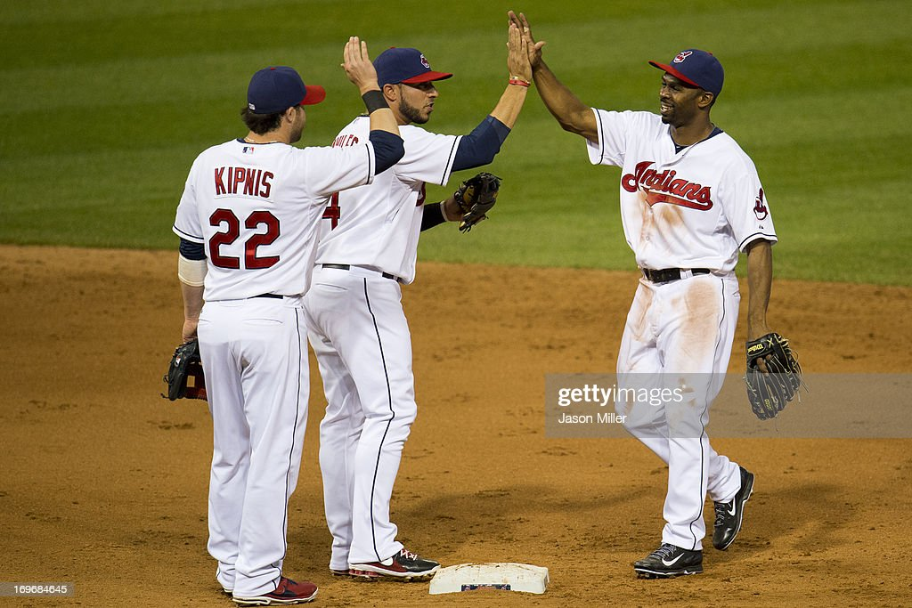 <a gi-track='captionPersonalityLinkClicked' href=/galleries/search?phrase=Jason+Kipnis&family=editorial&specificpeople=5330784 ng-click='$event.stopPropagation()'>Jason Kipnis</a> #22 celebrates with <a gi-track='captionPersonalityLinkClicked' href=/galleries/search?phrase=Mike+Aviles&family=editorial&specificpeople=4944765 ng-click='$event.stopPropagation()'>Mike Aviles</a> #4 and Michael Bourn #24 of the Cleveland Indians after the Indians defeated the Cincinnati Reds at Progressive Field on May 30, 2013 in Cleveland, Ohio. The Indians defeated the Reds 7-1.