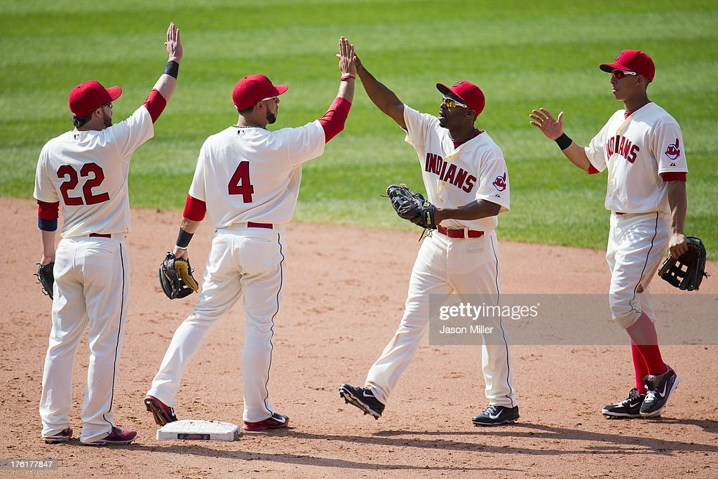 <a gi-track='captionPersonalityLinkClicked' href=/galleries/search?phrase=Jason+Kipnis&family=editorial&specificpeople=5330784 ng-click='$event.stopPropagation()'>Jason Kipnis</a> #22 <a gi-track='captionPersonalityLinkClicked' href=/galleries/search?phrase=Mike+Aviles&family=editorial&specificpeople=4944765 ng-click='$event.stopPropagation()'>Mike Aviles</a> #4 <a gi-track='captionPersonalityLinkClicked' href=/galleries/search?phrase=Michael+Bourn&family=editorial&specificpeople=835742 ng-click='$event.stopPropagation()'>Michael Bourn</a> #24 and Michael Brantley #23 of the Cleveland Indians celebrate after defeating the Los Angeles Angels of Anaheim at Progressive Field on August 11, 2013 in Cleveland, Ohio. The Indians defeated the Angels 6-5.