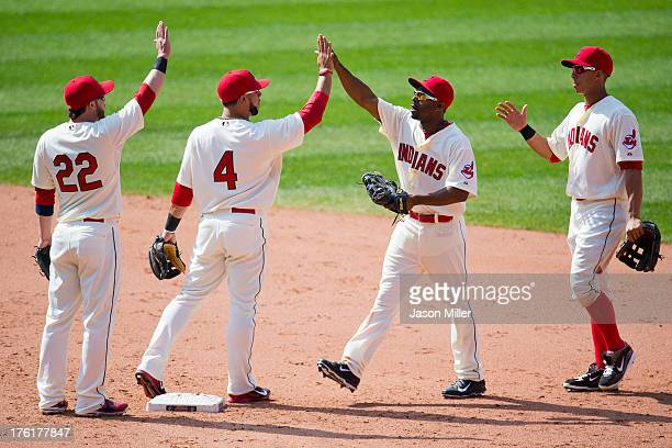 Jason Kipnis Mike Aviles Michael Bourn and Michael Brantley of the Cleveland Indians celebrate after defeating the Los Angeles Angels of Anaheim at...