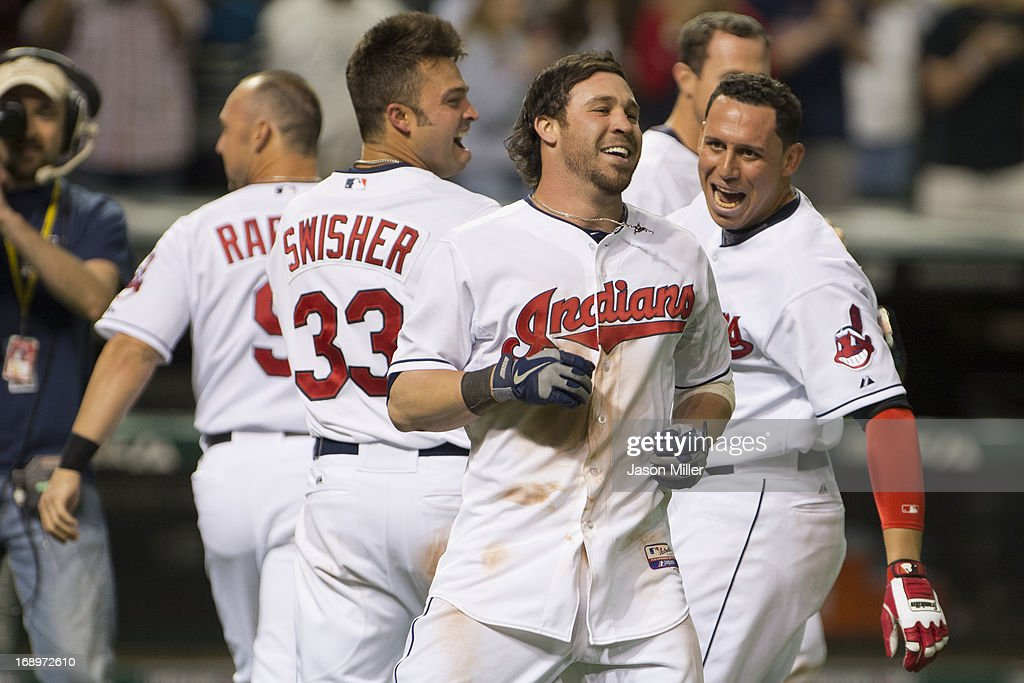 <a gi-track='captionPersonalityLinkClicked' href=/galleries/search?phrase=Jason+Kipnis&family=editorial&specificpeople=5330784 ng-click='$event.stopPropagation()'>Jason Kipnis</a> #22 of the Cleveland Indians celebrates after hitting a walk-off three-run home run in the tenth inning against the Seattle Mariners at Progressive Field on May 17, 2013 in Cleveland, Ohio. The Indians defeated the Mariners 6-3.