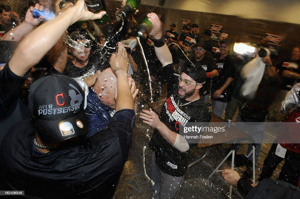 <a gi-track='captionPersonalityLinkClicked' href=/galleries/search?phrase=Jason+Kipnis&family=editorial&specificpeople=5330784 ng-click='$event.stopPropagation()'>Jason Kipnis</a> #22 of the Cleveland Indians celebrates with champagne in the clubhouse with teammates after a win of the game against the Minnesota Twins on September 29, 2013 at Target Field in Minneapolis, Minnesota. The Indians defeated the Twins 5-1 and clinched a American League Wild Card berth.